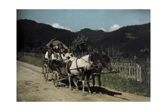 People Ride in a Cart Pulled by Two Horses-Hans Hildenbrand-Photographic Print