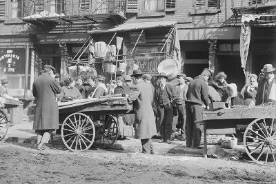 People Shopping around Push Cart--Photographic Print