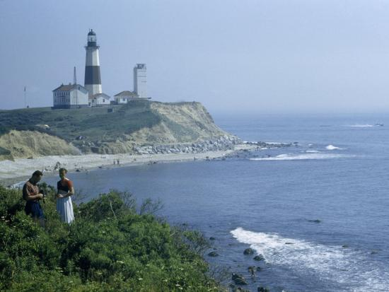 People Stand on Point across Bay from Montauk Point Light-B^ Anthony Stewart-Photographic Print