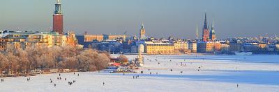 People Strolling across Frozen Riddarfjarden, Riddarholmen, Stockholm, Sweden--Photographic Print
