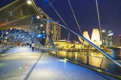 People Strolling on the Helix Bridge Towards the Marina Bay Sands and Artscience Museum at Night-Fraser Hall-Photographic Print