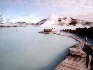 People Swim in the Blue Lagoon Spa in Grindavik, Iceland