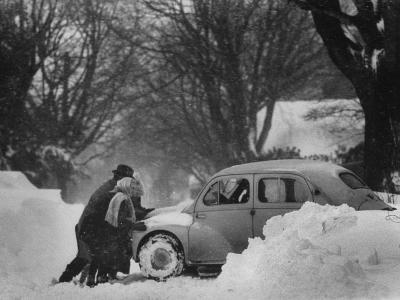 People Trying to Push a Snowbound Car--Photographic Print