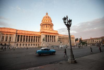 People Walk the Streets and a Classic American Car Drives Past the El Capitolio Building, Havana-Eric Kruszewski-Photographic Print