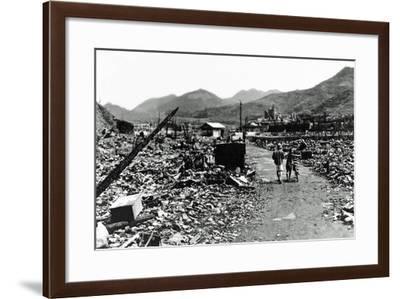 People Walk Through the Charred Ruins of Nagasaki--Framed Photographic Print