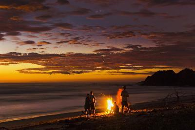 People with Driftwood Fire at Sunset on Playa Guiones Beach-Rob Francis-Photographic Print