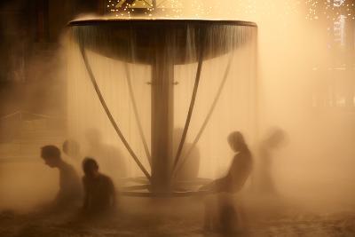 Peoples Sitting in Fountain in Aqua Park-Maksym Gorpenyuk-Photographic Print