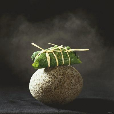 Fish Wrapped in a Leaf on a Stone