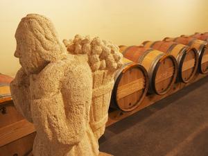 Barrel Cellar for Aging Wines in Oak Casks, Chateau La Grave Figeac, Bordeaux, France by Per Karlsson