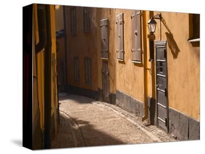 Cobblestone Street in Gamla Stan, Iron Cellar Door and Old Lamp, Stockholm, Sweden