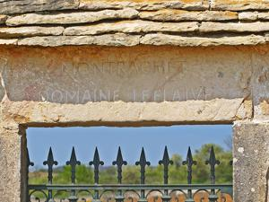 Gate and Key Stone Carved with Montrachet, Domaine Leflaive, Grand Cru Vineyard, Bourgogne, France by Per Karlsson