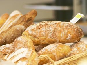 Loaf of Bread in Bakery, Le Brusc, Var, Cote d'Azur, France by Per Karlsson