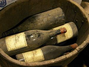 Magnum Bottles in Wooden Vat at Chateau Saint Cosme, Gigondas, Vaucluse, Rhone, Provence, France by Per Karlsson