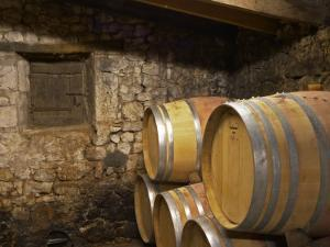 Oak Barrique Barrels with Aging Red Wine, Jute Chateau Belingard, Bergerac, Dordogne, France by Per Karlsson