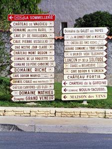 Road Signs to Wine Producers in Chateauneuf-Du-Pape, France by Per Karlsson