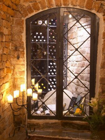 Wine Cellar with Bottles Behind Iron Bars, Stockholm, Sweden