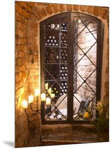 Wine Cellar with Bottles Behind Iron Bars, Stockholm, Sweden by Per Karlsson
