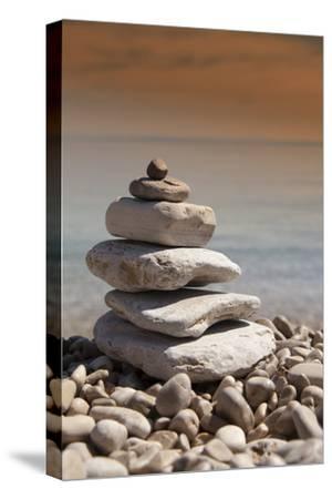 Stack of Stones, Zen Concept, on Sandy Beach
