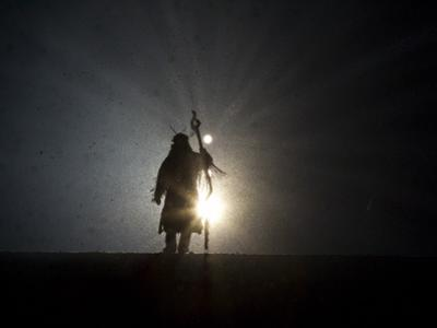 Performer is Silhouetted at the Opening Ceremonies for the XXI Olympic Winter Games in Vancouver