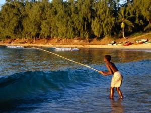 Boy Fishing off Beach, Tofo, Mozambique by Pershouse Craig