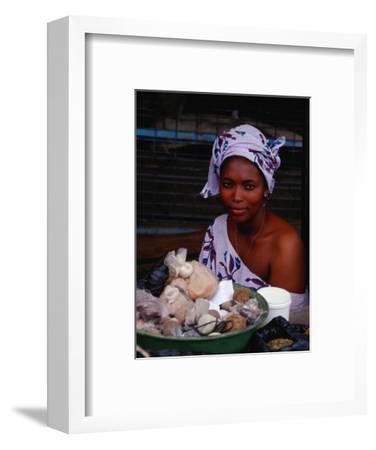 Female Spice Vendor at Market, Looking at Camera, Yamoussoukro, Cote d'Ivoire