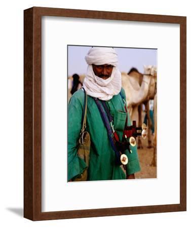 Tuareg Sword Salesman at Camel Market, Agadez, Niger