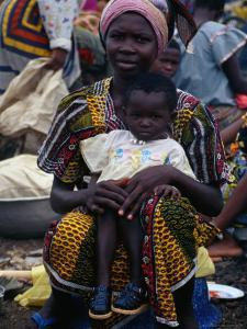 Woman with Baby at Monday Market in Kong, Looking at Camera, Cote d'Ivoire by Pershouse Craig
