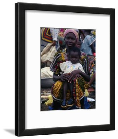 Woman with Baby at Monday Market in Kong, Looking at Camera, Cote d'Ivoire