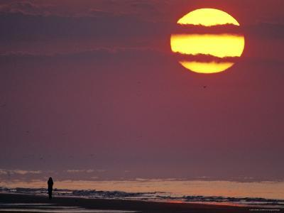 Person Silhouetted on the Beach at Sunrise-Kenneth Garrett-Photographic Print