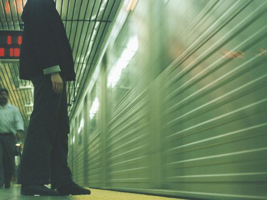 Person Waiting For Subway--Photographic Print