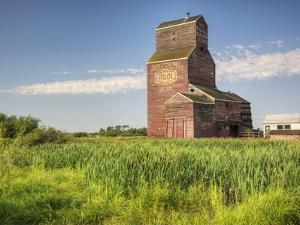 A Derelict Grain Elevator Weathers Away on the Canadian Prairie by Pete Ryan