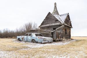 A dilapidated 1966 Ford Galaxie parked next to an abaondoned wind-powered grist mill. by Pete Ryan