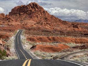 The Valley of Fire Highway Winds Towards Lake Mead, Nevada by Pete Ryan