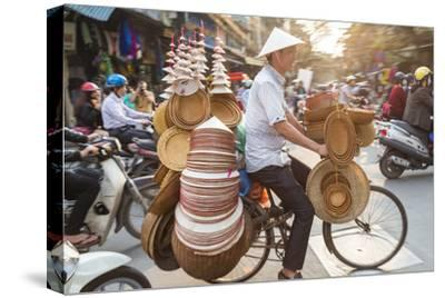 Basket and Hat Seller on Bicycle, Hanoi, Vietnam