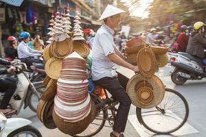Basket and Hat Seller on Bicycle, Hanoi, Vietnam by Peter Adams