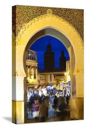 Blurred People Passing Through the Blue Gate, Fez, Morocco