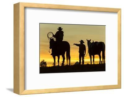 Cowboys and Horses in Silhouette at Dawn on Ranch, British Colombia, Canada