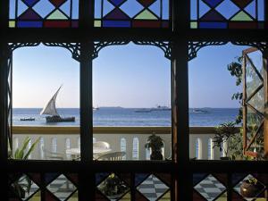 Dhow Through Window, Zanzibar, Tanzania by Peter Adams
