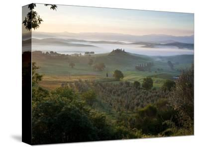 Ground fog at dawn in Val d'Orcia