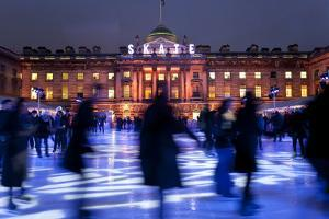 Ice Skaters at Somerset House Ice Rink London England UK by Peter Adams