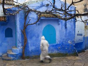 Man Wearing a Djellaba on the Street, Chefchaouen, Morocco by Peter Adams