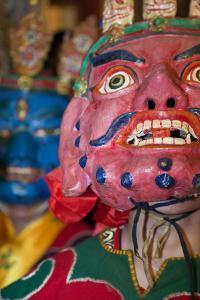 Masked Dancers at Tibetan Buddhist Monastery, Xinglong, Sichuan, China by Peter Adams