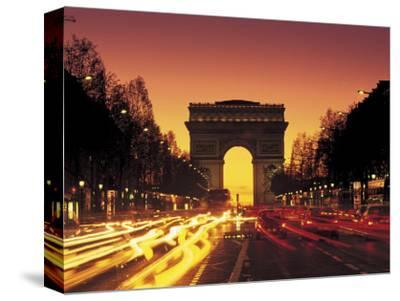 Paris, France, Arc De Triomphe at Night