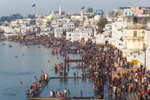 Pilgrims on their Way to Holy Pushkar Lake, Pushkar, Rajasthan, India by Peter Adams