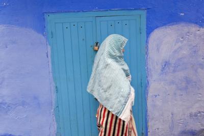 Woman in Narrow Lane Chefchaouen, Morocco