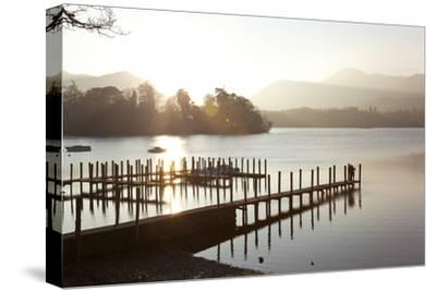 Young Couple on Pier, Sunset, Derwent Water, Cumbria, UK