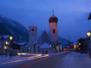 Church in Winter Snow at Dusk, St. Anton Am Arlberg, Austrian Alps, Austria, Europe by Peter Barritt