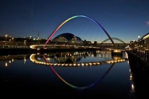 Gateshead Quays with Sage Gateshead and Millennium Bridge at Night by Peter Barritt