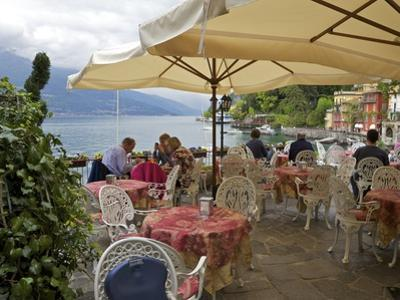 Lakeside View of Cafe in Medieval Village of Varenna, Lake Como, Lombardy, Italian Lakes, Italy by Peter Barritt