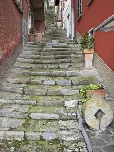 Medieval Cobbled Back Streets of Varenna, Lake Como, Lombardy, Italy, Europe by Peter Barritt
